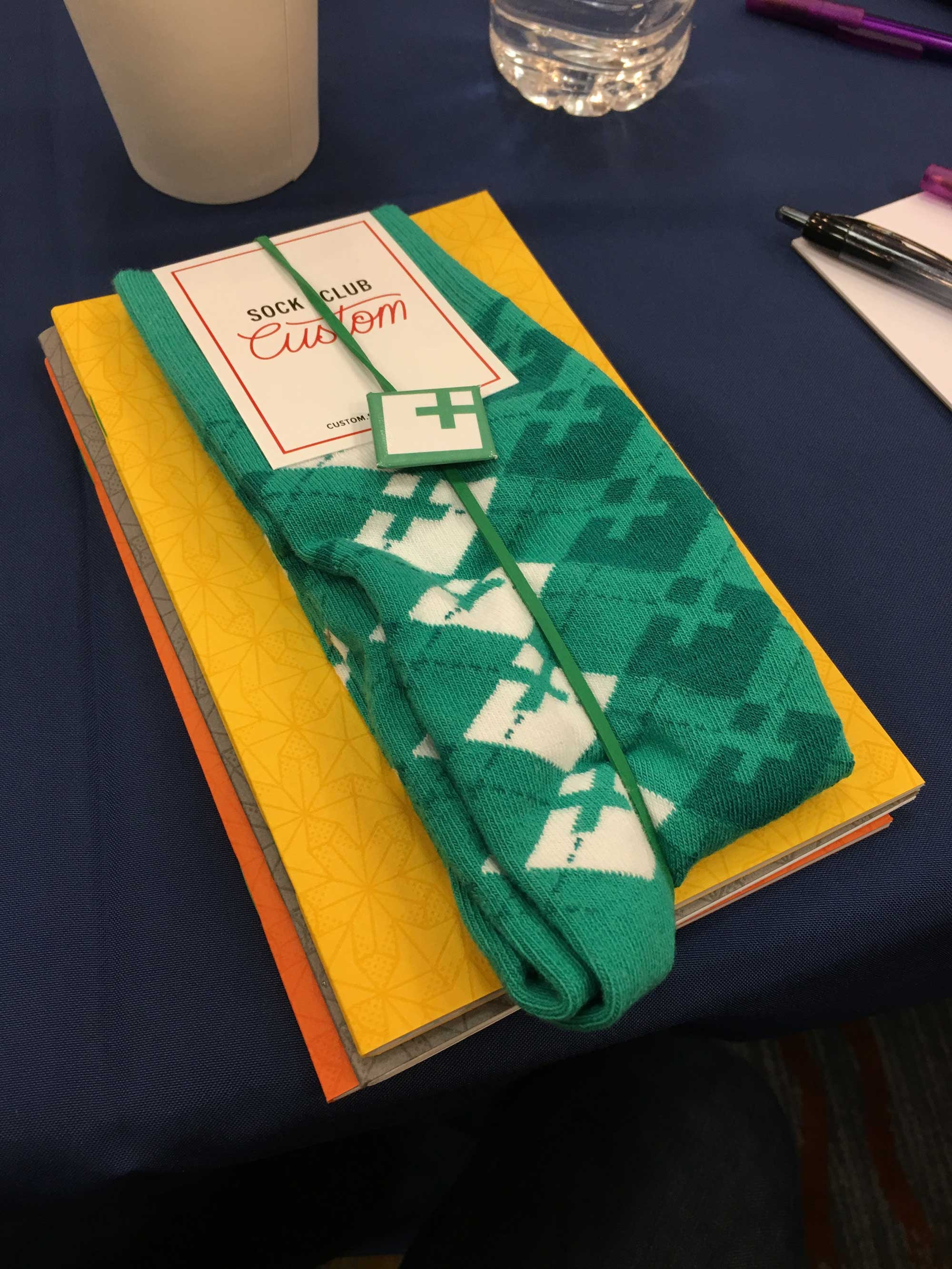 New Company swag, including notebooks and socks